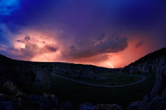 Lightening and storm over hills in the night Stock Image
