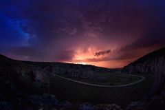 Lightening and storm over hills in the night Royalty Free Stock Photo