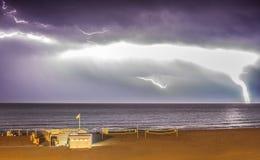 Lightening storm over sea Stock Photos