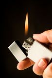 Lighter. With hand and flamme Stock Image