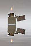 Lighter. Lighted lighter with vawy reflection Royalty Free Stock Photo