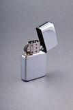 Lighter. Silver zippo lighter  on gray background Stock Photos