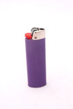 Lighter. A single purple lighter made in France for smokers. Image isolated on white studio background Stock Images
