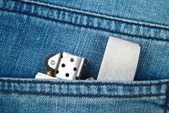 Lighter in the back pocket of jeans Royalty Free Stock Photography