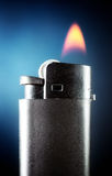 Lighter with burning flame Royalty Free Stock Images