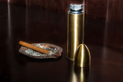 Lighter and cigarette With ashtray Stock Photos