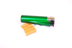 Lighter on cigarettes Royalty Free Stock Photography