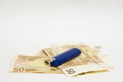 Lighter on fifty euro banknotes Stock Images