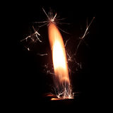 Lighter fire with sparks on black background Royalty Free Stock Photo