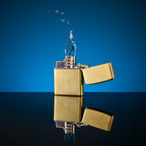 Lighter and the flame out of the water Stock Image