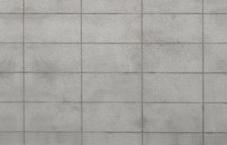 The lighter grey color of rough texture concrete wall skin with grid line pattern on cement plaster surface. For background stock photos