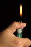 Lighter in hand. Stock Images