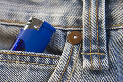 Lighter in jeans pocket. Blue lighter in washed, stylish jeans pocket Royalty Free Stock Photo