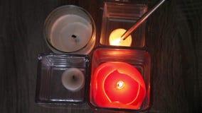 Lighter lights candles