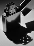 Lighter. Still life. Lighter on the table with shadows. monochrome Royalty Free Stock Photography
