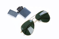 Lighter And Sunglasses Stock Photos