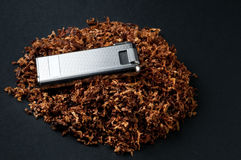 Lighter and tobacco Royalty Free Stock Image