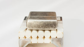 Lighter on the top of cigarettes. Royalty Free Stock Photography