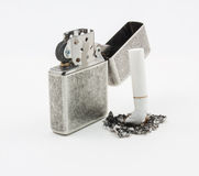 Lighter on the top of cigarettes. Royalty Free Stock Images