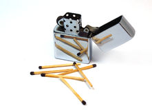Lighter Zip. Petrol lighter against wooden sticks Stock Photo