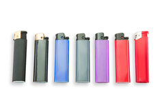 Lighters. Of different colors, plastic ,  for placing the logo, set of colored , colored  on white background, gas , Photo of  on white background Royalty Free Stock Photos