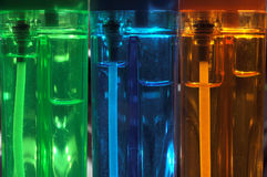 Lighters closeup. Close view of three colorful lighters Stock Images