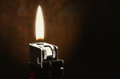 Lighters in the dark room Royalty Free Stock Photography