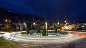 Lightextractors around a roundabout in the city of Innsbruck royalty free stock image