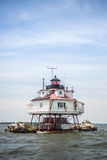 Lighthhouse. A lighthouse on a small rock island in the middle of bay Stock Photos