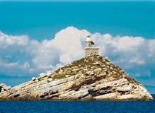 Lighthous em uma rocha branca na Ilha de Elba Fotografia de Stock