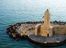 Lighthouse. A small lighthouse in an Italian harbor Stock Photos