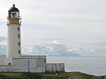 Lighthouse. A scenic lighthouse on the west coast of the Scottish Highlands Royalty Free Stock Images