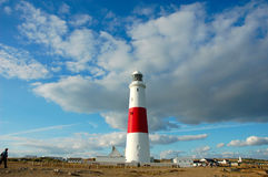 Lighthouse. On a Seashore - Cloudy Skies stock image