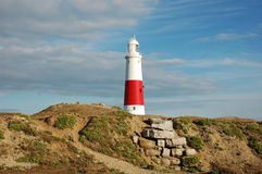 Lighthouse. On a Seashore - Cloudy Skies Stock Photography