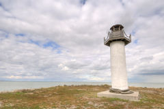 Lighthouse. Small inlet lighthouse on the eastern end of Lake Erie on big fall day in 2009 Royalty Free Stock Photo