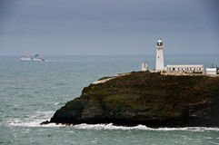 Lighthouse. A lighthouse with a view of the sea Stock Images
