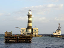 Lighthouse. Elphinstone lighthouse in the red sea Stock Image