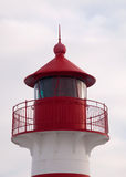 Lighthouse. Top of small Lighthouse on light cloudy sky Stock Photo