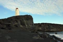 Lighthouse. Lighthouse on rocky coast on North seashore of Iceland Stock Photo