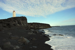 Lighthouse. Lighthouse on rocky coast on North seashore of Iceland Royalty Free Stock Images