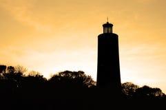 Lighthouse. On deep orange sky Stock Image