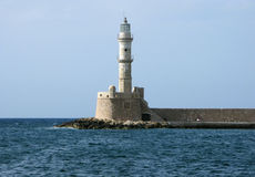 Lighthouse. Ancient lighthouse in the harbour of Xania in Crete royalty free stock photos