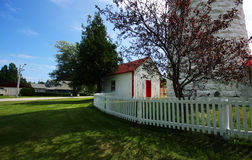 Lighthouse. A Lighthouse with a white picket fence Stock Photo