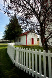 Lighthouse. With a white picket fence Stock Image