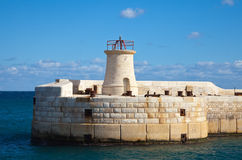 Lighthouse. At entrance in Grand Harbour (Valletta, Malta Royalty Free Stock Images