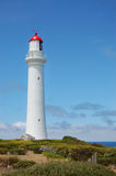 Lighthouse. White lighthouse against blue sky Royalty Free Stock Photo