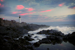 Lighthouse. And rocky coast in early morning stock images