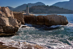 Lighthouse. On a small cape in seaside town Kassis Royalty Free Stock Photography