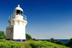 Lighthouse. On a bright day with clear skies royalty free stock image