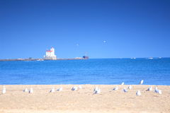 Lighthouse 2. Beach, seagulls and Fairport Harbor Lighthouse stock image